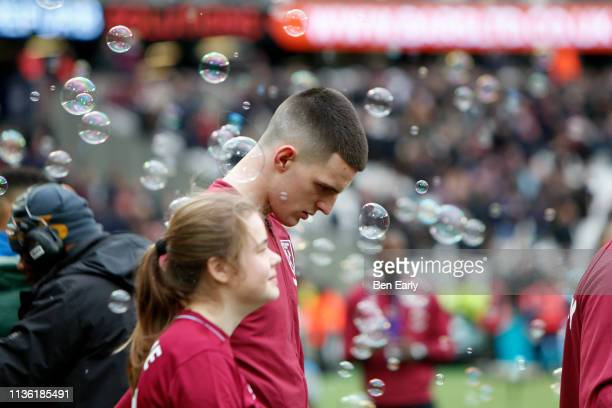 Declan Rice of West Ham United walks out for the Premier League match between West Ham United and Huddersfield Town at London Stadium on March 16...