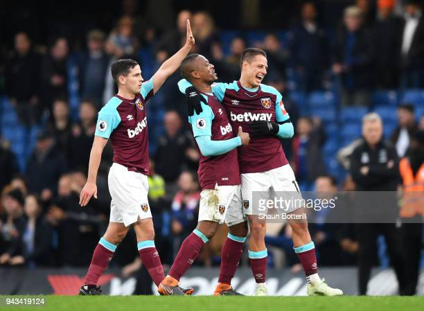 Declan Rice Patrice Evra and Javier Hernandez of West Ham United celebrates after the Premier League match between Chelsea and West Ham United at...