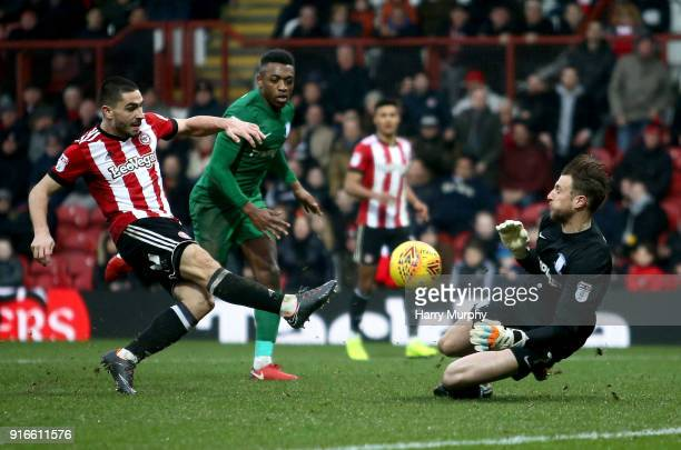 Declan Rudd of Preston North End blocks a shot from Neal Maupay during the Sky Bet Championship match between Brentford and Preston North End at...