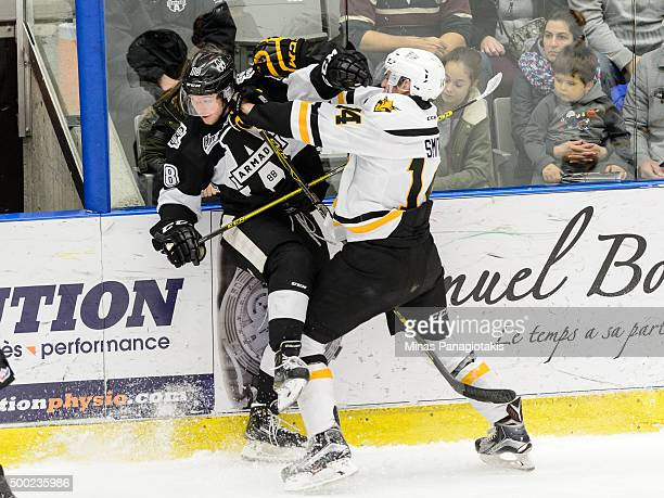 Declan Smith of the Cape Breton Screaming Eagles checks Tyler Hylland of the BlainvilleBoisbriand Armada during the QMJHL game at the Centre...