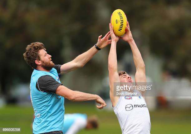 Declan Watson of the Kangaroos and Lachlan Hansen of the Kangaroos compete for the ball during a North Melbourne Kangaroos AFL training session at...