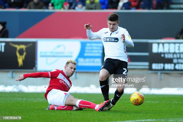 Decland John of Swansea City is tackled by Andreas Weimann of Bristol City during the Sky Bet Championship match between Bristol City and Swansea...
