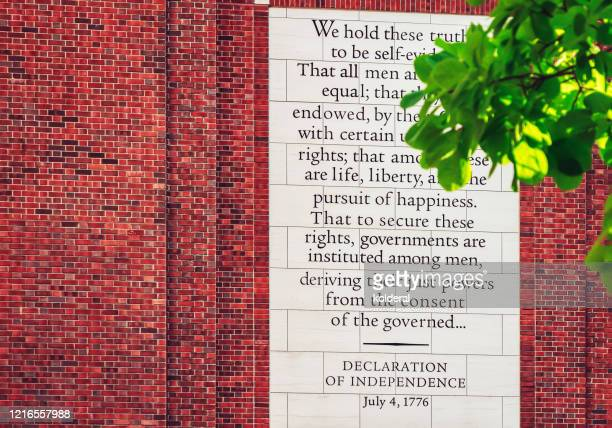declaration of independence text on brick wall in philadelphia - declaration of independence stock pictures, royalty-free photos & images