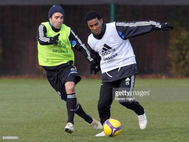 Deco and Florent Malouda of Chelsea in action during a training session at the Chelsea FC training ground on January 30, 2009 in Cobham, United...