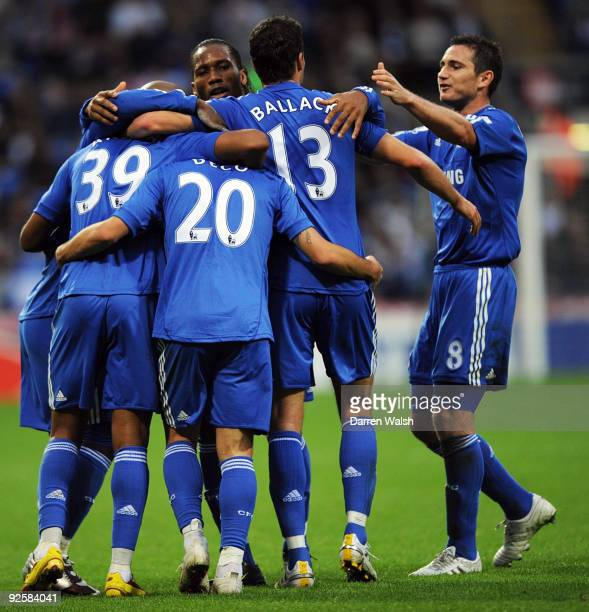 Deco celebrates his goal for Chelsea with his team mates during the Barclays Premier League match between Bolton and Chelsea at the Reebok Stadium on...