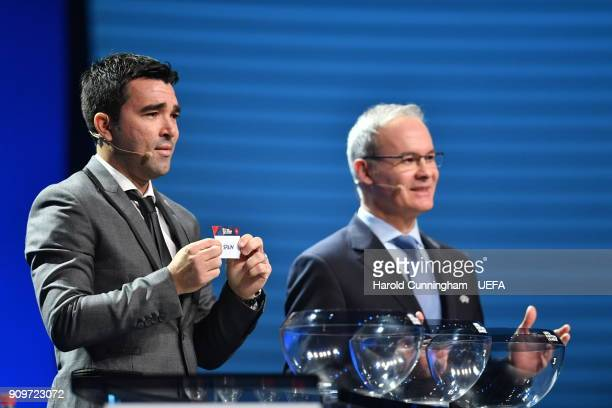 Deco draws out name of Spain beside UEFA Deputy General Secretary Giorgio Marchetti during the UEFA Nations League Draw League A on January 24 2018...