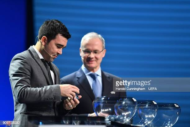 Deco draws out names beside UEFA Deputy General Secretary Giorgio Marchetti during the UEFA Nations League Draw League A on January 24 2018 in...