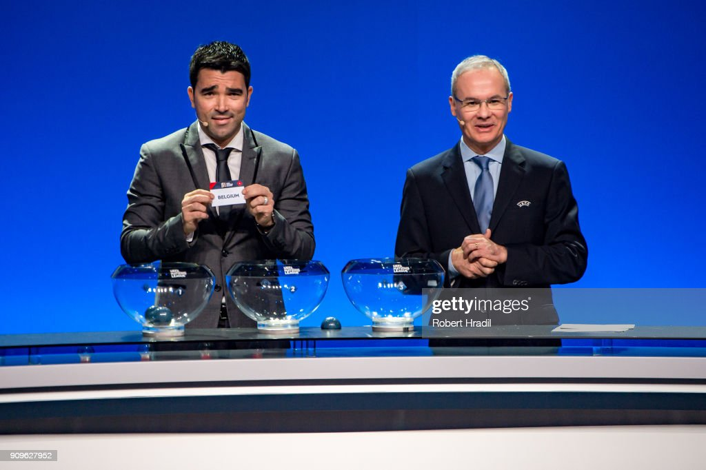 Deco, former Brazilain football player, (L) shows the slip of Belgium during the UEFA Nations League Draw 2018 at Swiss Tech Convention Center on January 24, 2018 in Lausanne, Switzerland.