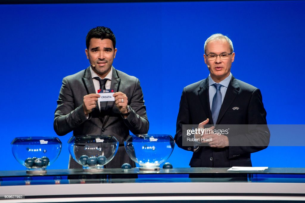 Deco, former Brazilain football player, (L) shows the slip of Croatia during the UEFA Nations League Draw 2018 at Swiss Tech Convention Center on January 24, 2018 in Lausanne, Switzerland.