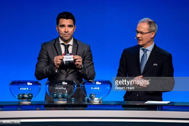 Deco former Brazilain football player shows the slip of Poland during the UEFA Nations League Draw 2018 at Swiss Tech Convention Center on January 24...