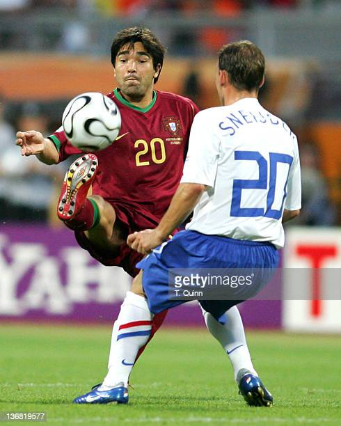 Deco hooks the ball over Wesley Sneijder. Despite playing two men short Portugal hung on to beat Holland 1-0 as both team finished with nine men each...