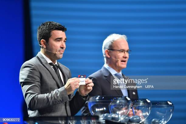Deco in the company of UEFA Deputy General Secretary Giorgio Marchetti draws out the name of Poland during the UEFA Nations League Draw League A on...