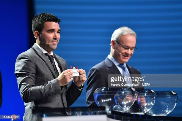 Deco in the company of UEFA Deputy General Secretary Giorgio Marchetti draws out the name of Portugal during the UEFA Nations League Draw League A on...