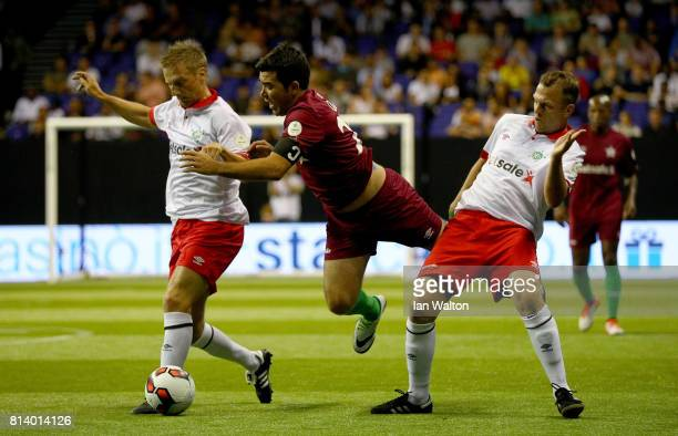 Deco is tackled by Daniel Jensen during the Star Sixe's match between Portugal and Denmark in the at The O2 Arena on July 13 2017 in London England