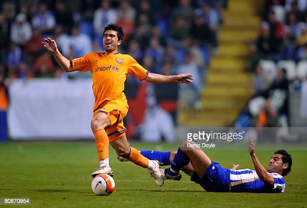 Deco of Barcelona is fouled by Ivan Sanchez 'Riki' of Deportivo during the La Liga match between Deportivo La Coruna and Barcelona at the Riazor...