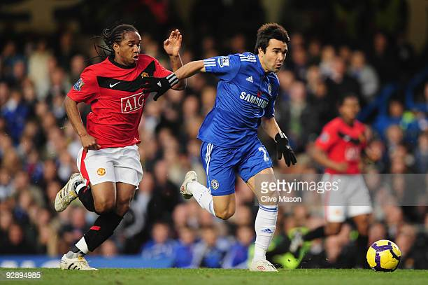 Deco of Chelsea is pursued by Anderson of Manchester United during the Barclays Premier League match between Chelsea and Manchester United at...