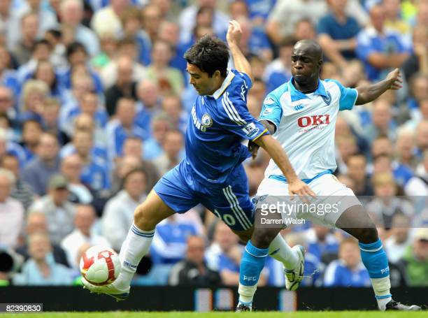 Deco of Chelsea is tackled by Lassana Diarra of Portsmouth during the Barclays Premier League match between Chelsea and Portsmouth at Stamford Bridge...