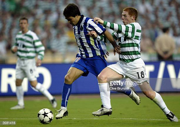 Deco of FC Porto takes the ball past Neil Lennon of Celtic during the UEFA Cup Final match held on May 21, 2003 at the Estadio Olimpico in Seville,...
