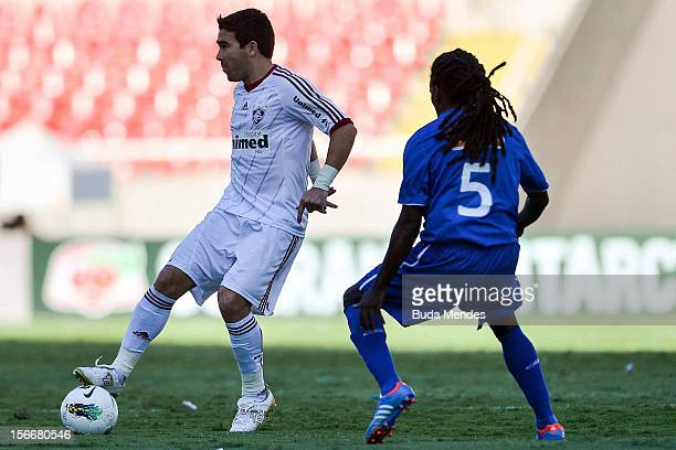 Deco of Fluminense struggles for the ball with Tinga of Cruzeiro during a match between Cruzeiro and Fluminense as part of Serie A 2012 at Engenhao...