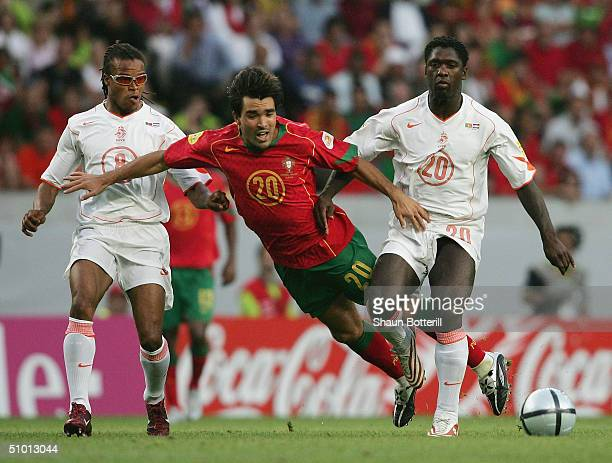 Deco of Portugal battles with Edgar Davids and Clarence Seedorf of Holland during the UEFA Euro 2004 Semi Final match between Portugal and Holland at...