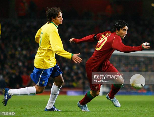 Deco of Portugal evades Edmilson of Brazil during the International friendly match between Brazil and Portugal at the Emirates Stadium on February 6...