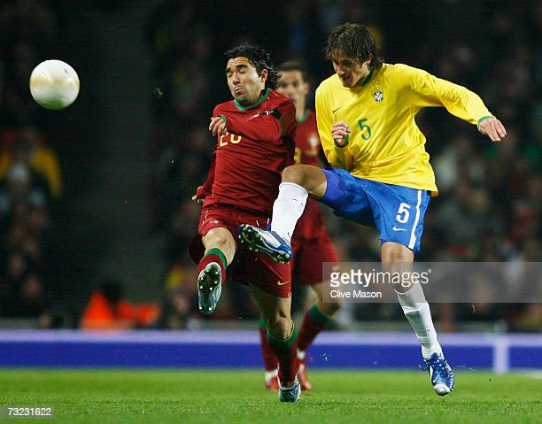 Deco of Portugal is challenged by Edmilson of Brazil during the International friendly match between Brazil and Portugal at the Emirates Stadium on...