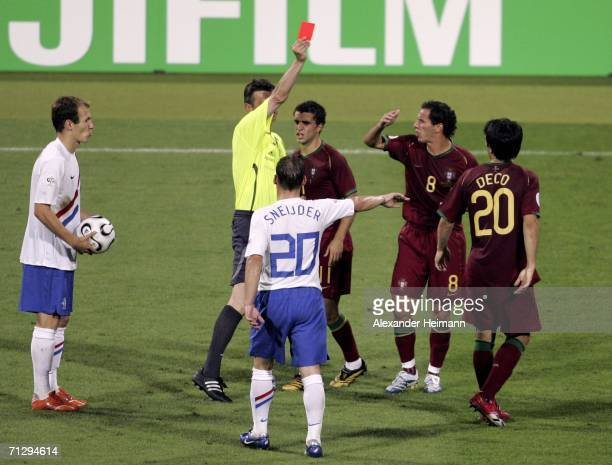 Deco of Portugal is shown the red card by Referee Valentin Ivanov of Russia after his second bookable offence during the FIFA World Cup Germany 2006...