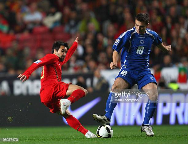 Deco of Portugal tangles with Zvjezdan Misimovic of Bosnia during the FIFA 2010 European World Cup qualifier first leg match between Portugal and...