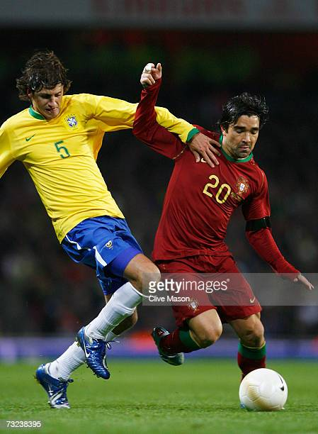 Deco of Portugal tussles with Edmilson of Brazil during the International friendly match between Brazil and Portugal at the Emirates Stadium on...