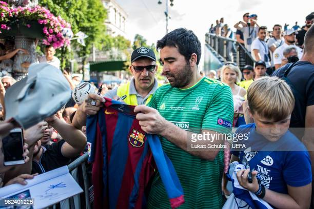 Deco of UEFA Champions League Legends gives autographs to fans during the Ultimate Champions Tournament at the Champions Festival ahead of the UEFA...