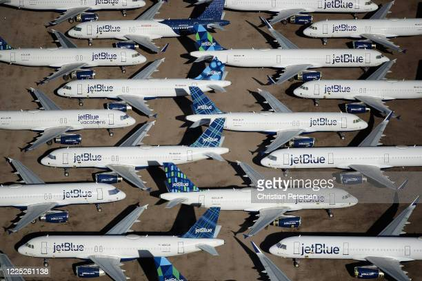Decommissioned and suspended jetBlue commercial aircrafts are seen stored in Pinal Airpark on May 16 2020 in Marana Arizona Pinal Airpark is the...