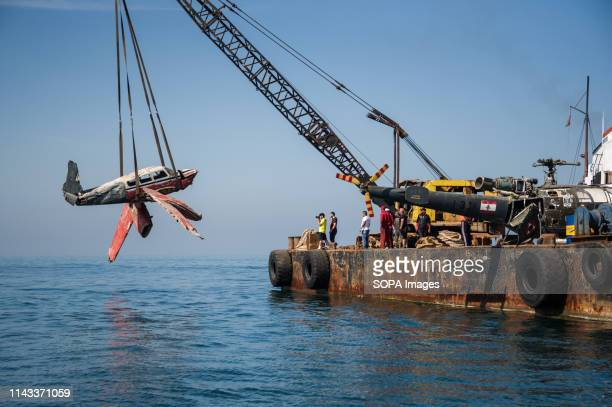 A decommissioned Cessna aircraft donated by the Lebanese Air force seen winched into the water during the project Decommissioned aircrafts are...