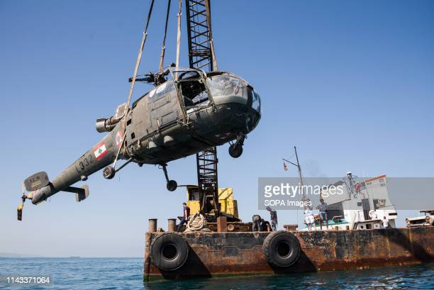 A decommissioned helicopter donated by the Lebanese Air force seen winched into the water during the project Decommissioned aircrafts are winched...