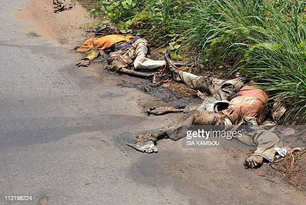 Decomposing corpses are seen roadside during a ONUCI patrol in the streets of Abidjan's polular district of Abobo on April 14 2011 President Alassane...