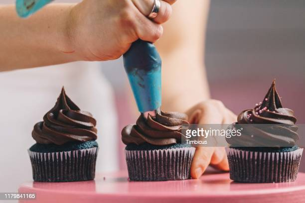 decorate cupcake - cake decoration stock pictures, royalty-free photos & images