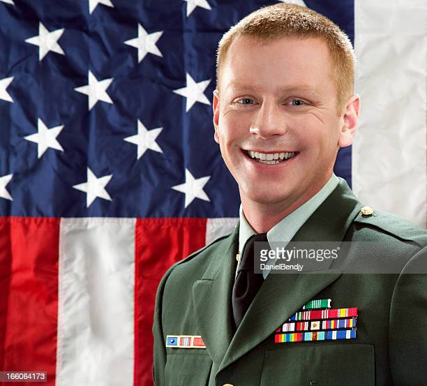 Decorated American Soldier with Class A Uniform Against USA Flag