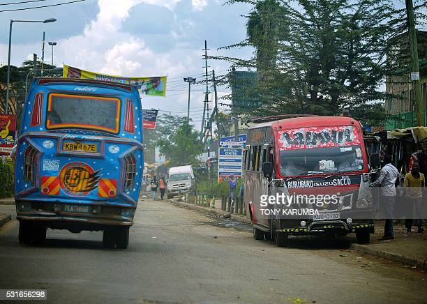 Decorated and refitted privatelyowned public transport buses popularly known as 'matatu' are seen at a dropoff point in Nairobi on April 14 2016 For...
