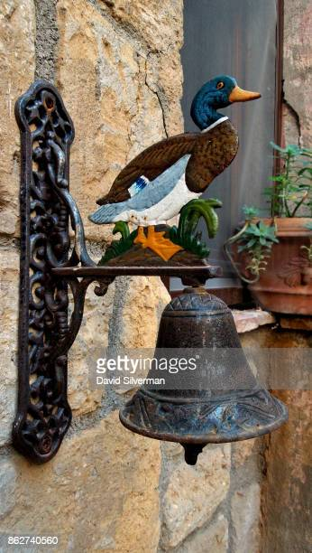 A decorated bell marks the entrance to a house on July 22 2015 in the medieval village of Pitigliano in the Grosseto province of Tuscany Italy...