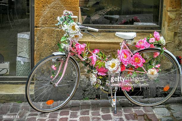Decorated Bicycle Parked On Footpath Against Wall
