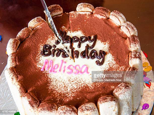 A Decorated Birthday Cake Says Happy Melissa In Icing The Delicious Looking Has White