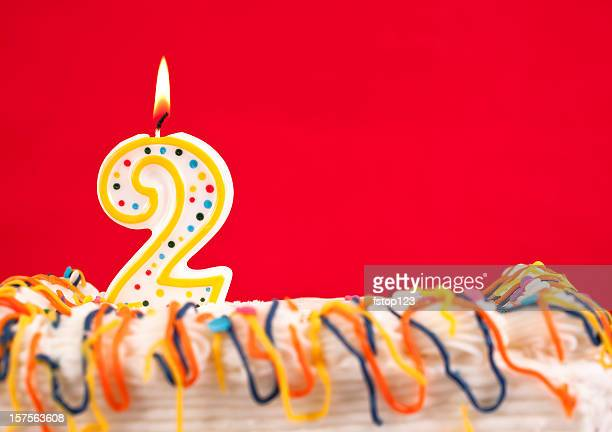 decorated cake  with number 2 burning candles - number 2 stock pictures, royalty-free photos & images