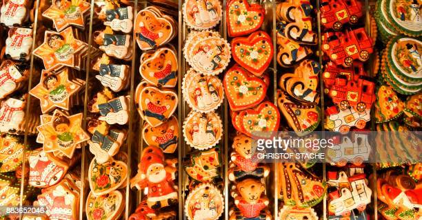 Decorated Christmas gingerbreads are displayed for sale at a booth on the opening day of the traditional Christmas Market in Nuremberg southern...
