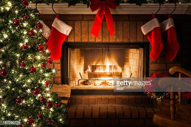 Decorated Christmas tree, blazing fire in fireplace, stockings, rocking chair