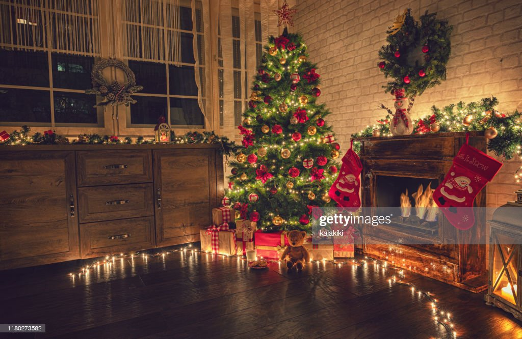 Decorated Christmas Tree Near Fireplace at Home : Stock Photo