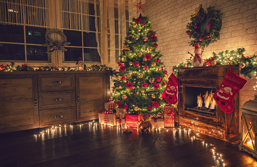Decorated Christmas Tree Near Fireplace at Home 1180273582