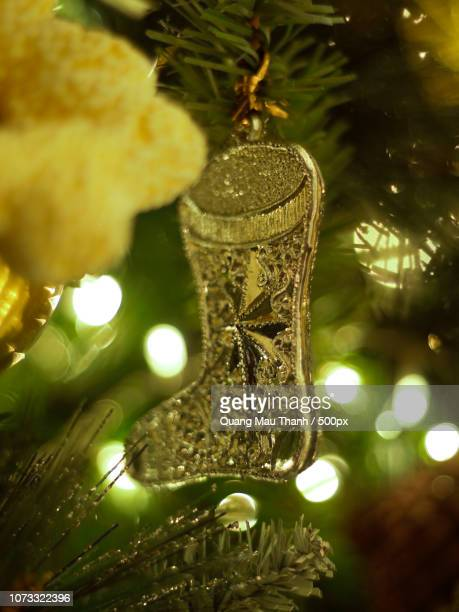 decorated christmas tree on  blurred, sparkling and fairy background - christmas background stock photos and pictures