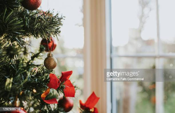 decorated christmas tree with glittery baubles - symbolism stock pictures, royalty-free photos & images