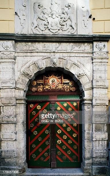 Decorated door building of the Brotherhood of the Blackheads Pikk Old Town of Tallinn Estonia