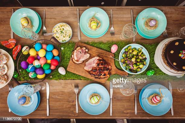 decorated easter table - easter stock pictures, royalty-free photos & images