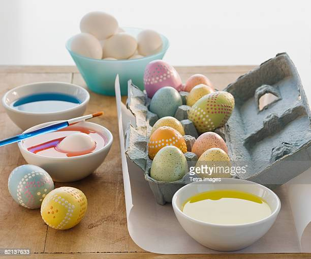 decorated eggs next to bowls of dye - easter decoration ストックフォトと画像